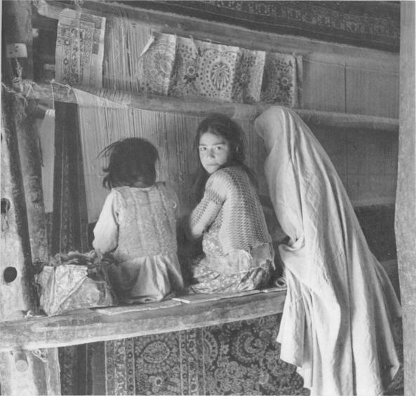 Girls weaving a carpet in hamdan 1922